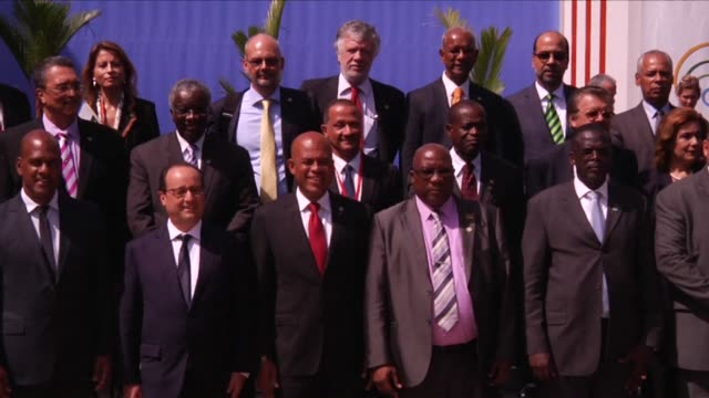 french president francois hollande and martinican president serge letchimy pose for a family photo alongside several ministers, following the opening... - french overseas territory stock videos & royalty-free footage