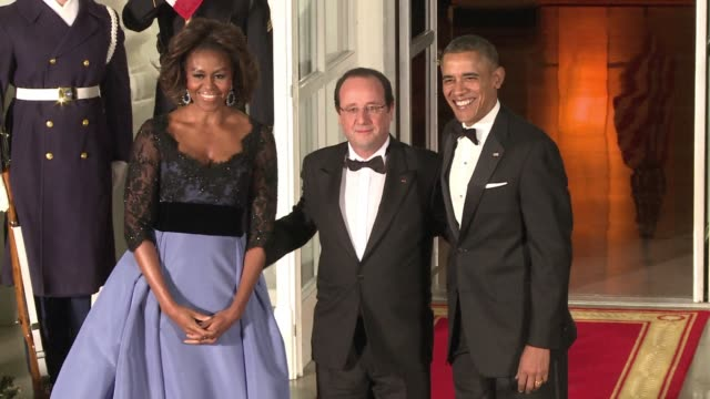 french president francois hollande arrived at the white house for a state dinner on tuesday evening. clean : hollande arrives at white house for... - state dinner stock videos & royalty-free footage