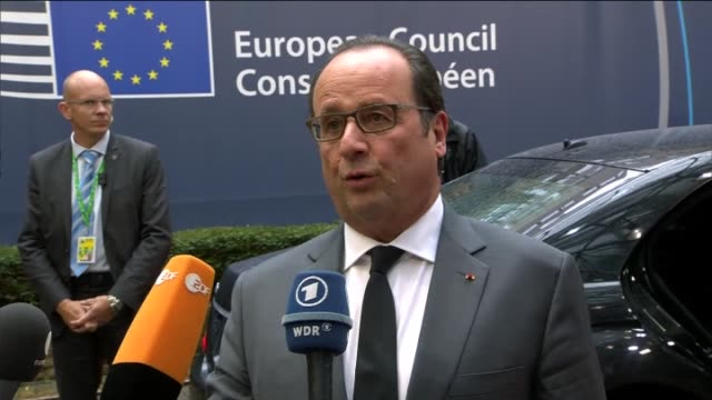 french president francois hollande arrives to take part in the european union summit on the migration crisis at the european council in brussels,... - françois hollande stock videos & royalty-free footage