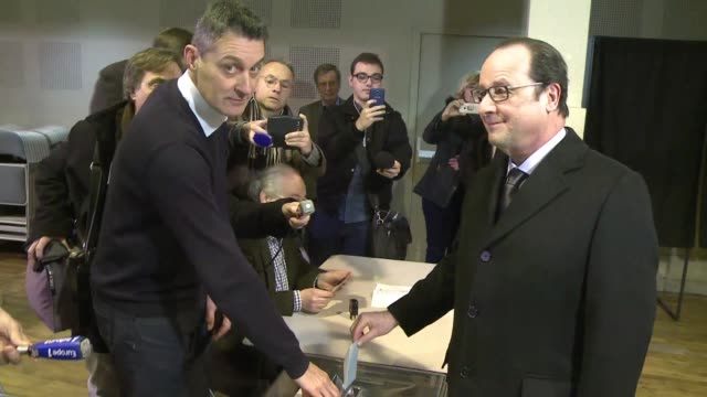 french president francois hollande casts his vote in tulle in key regional polls - tulle stock videos and b-roll footage