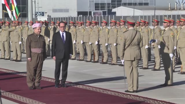 french president francois hollande is welcomed by iraqi kurdistan regional government president masoud barzani upon his arrival at erbil... - françois hollande stock videos & royalty-free footage