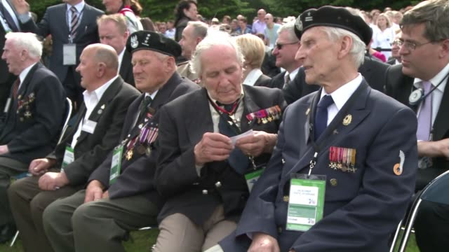 french president francois hollande pays tribute to the polish soldiers who died alongside the allied forces in wwii at the urville cemetary that is... - allied forces stock videos and b-roll footage