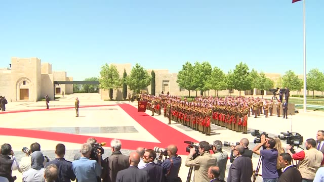 French President Francois Hollande reviews the Jordanian honor guards during an official welcoming ceremony at Al Husseinia palace in Amman Jordan on...