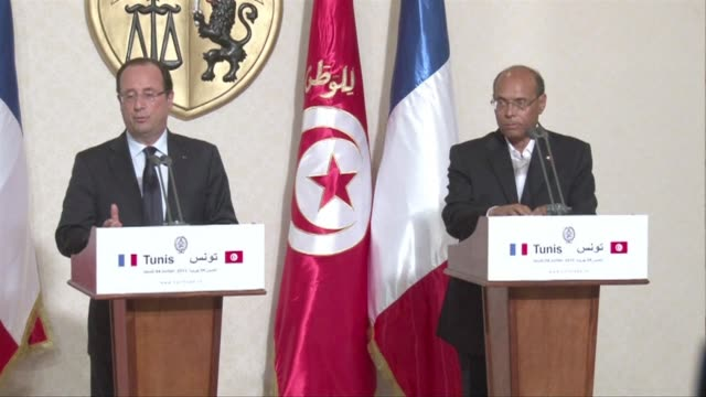 stockvideo's en b-roll-footage met french president francois hollande said on thursday that everything must be done to restore the democratic process in egypt on a visit to tunisia... - geboren in