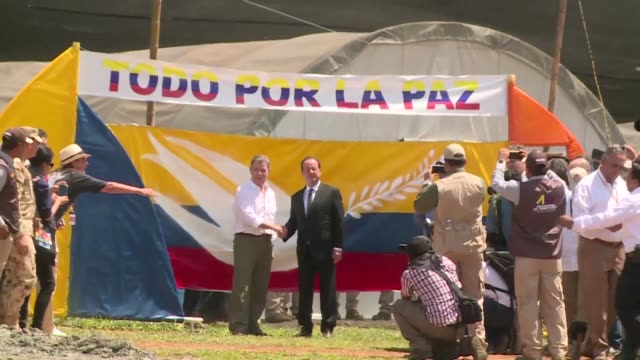 french president francois hollande visits a farc rebel disarmament zone in valle del cauca department colombia in support of colombia's peace process - disarmament stock videos and b-roll footage