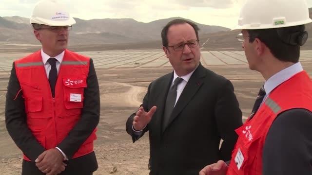 french president francois hollande visits edf's solar power plant in chile's bolero desert during his last tour through latin america - antofagasta region stock videos and b-roll footage
