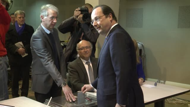french president francois hollande voted on sunday in the first round of local elections amid high voltage tension between his socialist government... - hometown bildbanksvideor och videomaterial från bakom kulisserna