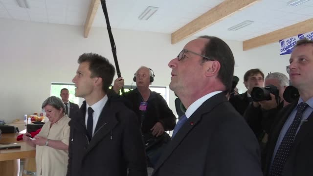 french president françois hollande watches presidential candidate emmanuel macron vote live on television from tulle france after voting there... - tulle stock videos and b-roll footage