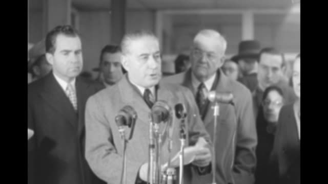 french prime minister rene mayer before microphones reading from notes vice president nixon and secretary of state dulles behind him others in bg he... - minister president stock videos and b-roll footage