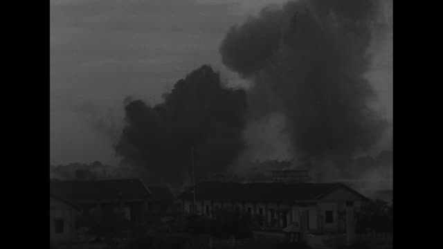 vídeos de stock, filmes e b-roll de french rear guard soldiers fire large artillery gun / ws explosion and white smoke / qs explosion with dirt smoke thrown / military plane flies above... - 1950