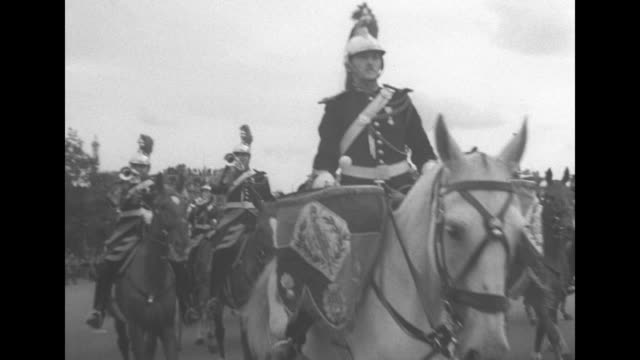 french republican guard mounted band approaches as it marches on paris street during parade celebrating visit of gen dwight eisenhower / drummer... - charles de gaulle stock videos and b-roll footage