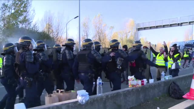 french riot police clear the aquitaine bridge in bordeaux after anti fuel hike demonstrators blocked the passage by burning tyres and creating... - aquitaine stock videos and b-roll footage