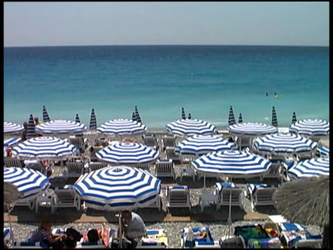 french riviera / cote d'azur beach umbrellas on sand - var stock videos & royalty-free footage