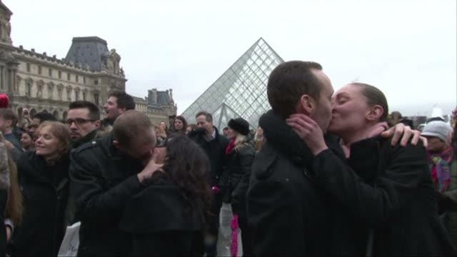 french romantics hold kissing flashmob at the paris louvre for valentine's day clean french kiss on valentine's day by the hund on february 14 2014... - flash mob stock videos and b-roll footage