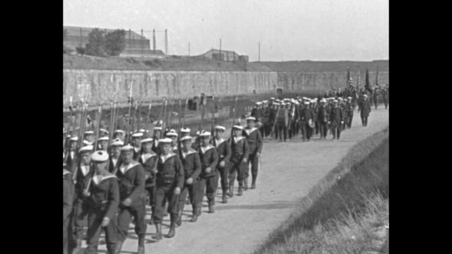 french sailors marching / american legionnaires who are world war i veterans walking in a group in parade during their visit to france - französische armee stock-videos und b-roll-filmmaterial