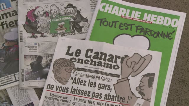 french satirical magazine le canard enchaine has said it received threats the day after the newsroom massacre at charlie hebdo leading to heightened... - publication stock videos & royalty-free footage