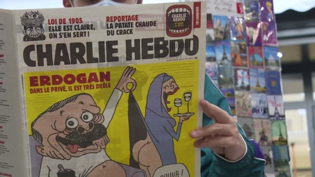 vídeos y material grabado en eventos de stock de french satirical weekly charlie hebdo mocks recep tayyip erdogan on the cover of its latest issue. the turkish president is portrayed in his pants,... - satírico