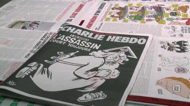 vídeos de stock, filmes e b-roll de french satirical weekly charlie hebdo will mark a year since the jihadist attack on its offices with a cover featuring a bloodied gun toting bearded... - sátira