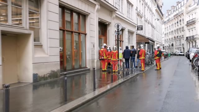 french security and medical workers on site after an incident in front of the former charlie hebdo headquarters and scene of a terrorist attack in... - terrorism stock videos & royalty-free footage