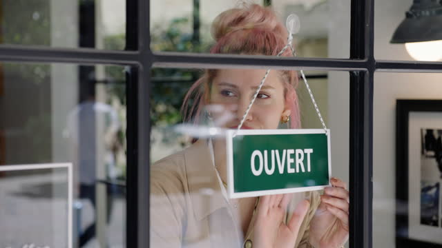 french small business owner opening a shop - french culture stock videos & royalty-free footage