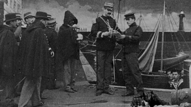 1899 b/w french soldiers greeting and escorting passenger disembarking from boat during a lightning storm - 19th century stock videos & royalty-free footage