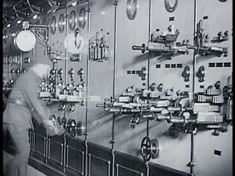 french soldiers in gear walking through tunnel. soldier examining large electric switches panels on wall. lighting circuitry. soldier w/ air pressure... - maginot linie stock-videos und b-roll-filmmaterial