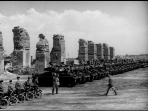 french soldiers manning tanks & motorcycles w/ ruins bg, tanks in line moving past unidentified kasbah ruins, vs moroccan goumier french army... - french army stock videos & royalty-free footage