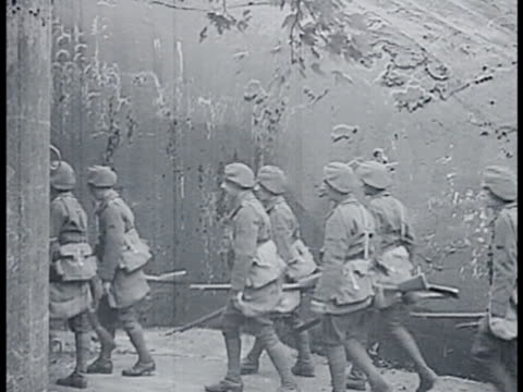 french soldiers marching by barbed wires. soldiers entering bunkers. int soldiers descending stairs. soldiers in full gear walking through tunnel. - maginot linie stock-videos und b-roll-filmmaterial