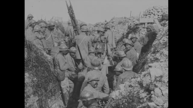 french soldiers with their weapons walk along a path at an encampment / french soldiers gather in a german trench / pans of the remains and rubble of... - trench stock videos & royalty-free footage