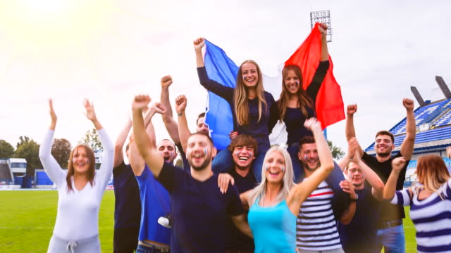 WS french sport fans celebrating at soccer stadium