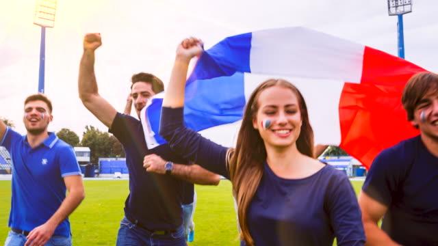 MS french sport fans celebrating at soccer stadium