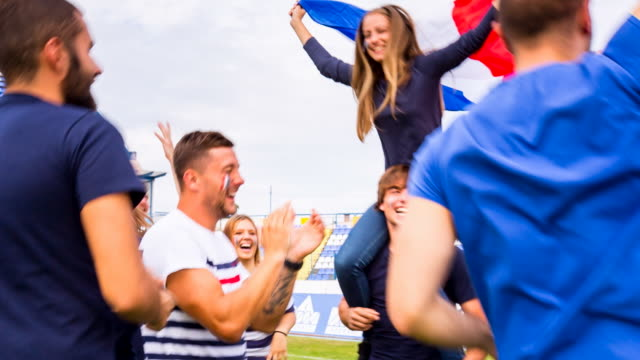 ms french sport fans dancing at soccer stadium - shoulder ride woman stock videos & royalty-free footage