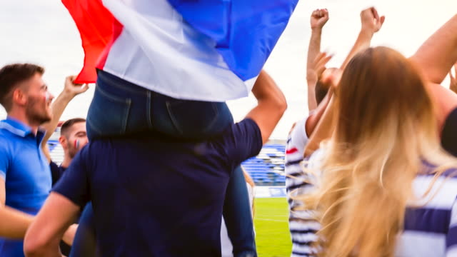 cu french sport fans dancing at soccer stadium - shoulder ride woman stock videos & royalty-free footage