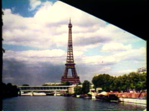 1953 ws pov french statue of liberty and eiffel tower, notre dame, cafe with people enjoying coffee, the arch of triumph / paris, france / audio - eiffel tower stock videos and b-roll footage