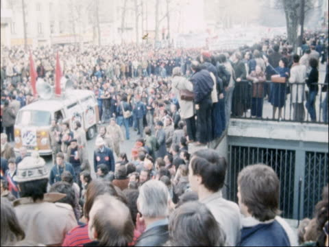 french steel strike; france: ext steel workers marching / slogans and placards held bu workers / high angle shot crowd marching tx 23.3.79/nat: - politics and government stock videos & royalty-free footage