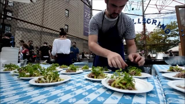 french swedish chefs bertrand grebaut magnus nilsson cooked up a picnic style lunch at brooklyns fort green flea market this weekend as part of le... - french food market stock videos & royalty-free footage