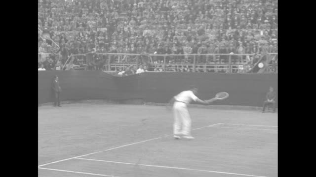 stockvideo's en b-roll-footage met french tennis player henri cochet and japanese player takeichi harada walk onto tennis court in koshien japan / harada on left side of court returns... - 1920 1929