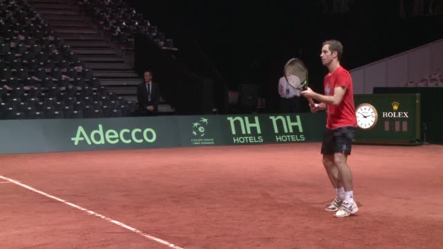 French tennis star Jo Wilfried Tsonga trains ahead of his opening match against Stanislas Wavrinka in the Davis Cup final pitting France against...
