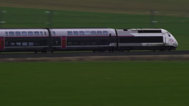 French TGV high speed train travels through green country landscape