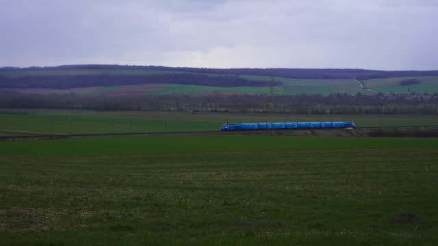 French TGV Ouigo high speed train travels through green country landscape