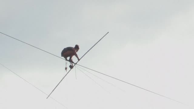 french tightrope artist tatiana mosio bongonga opens a new circus festival in prague by walking across the czech capital's river vltava - river vltava stock videos and b-roll footage