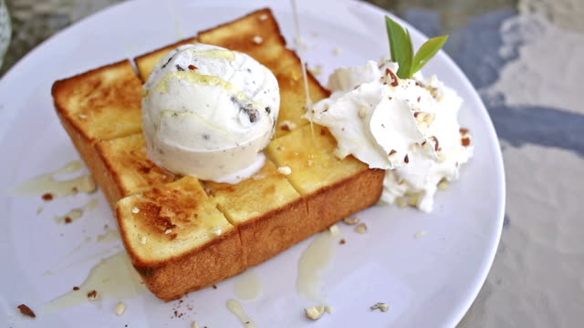 french toast with ice cream and honey syrup, dessert - french food stock videos & royalty-free footage