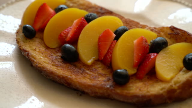 french toast with peach, strawberry and blueberry
