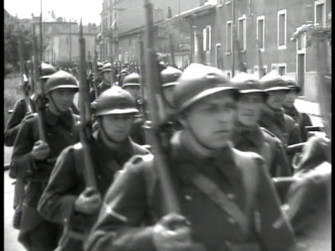french troops marching through town. gate sign 'caserne maginot' soldiers marching fg. digging trench. world war ii wwii trench warfare maginot line... - 1939 stock-videos und b-roll-filmmaterial