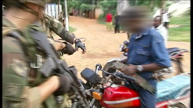 french troops to get international help to stop fighting between muslims and christians central african republic bangui ext french soldiers stopping... - gun belt stock videos and b-roll footage