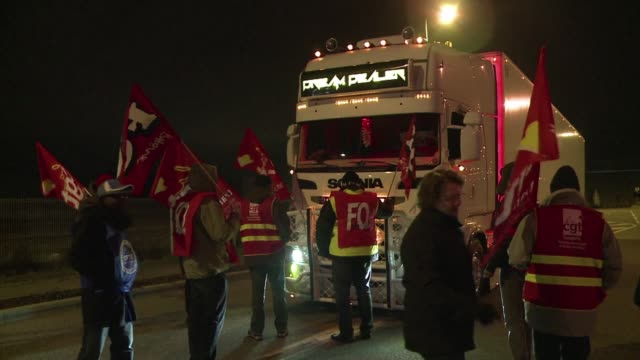 french truck drivers begin gathering on sunday night for a monday morning strike to demand higher wages - fordern stock-videos und b-roll-filmmaterial