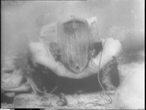 stockvideo's en b-roll-footage met french trucks are wrecked closeup of renault plaque / a soldier rides a motorcycle through wreckage / a truck is on fire / dead soldiers on the ground - geallieerde mogendheden