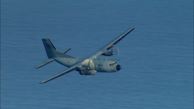 air to air, french version of hercules aircraft flying above sea near marseille, provence-alpes-cote d'azur, france - aereo militare video stock e b–roll