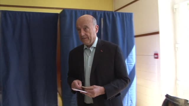 French veteran politican Alain Juppe arrives to cast his vote at a polling station in Bordeaux