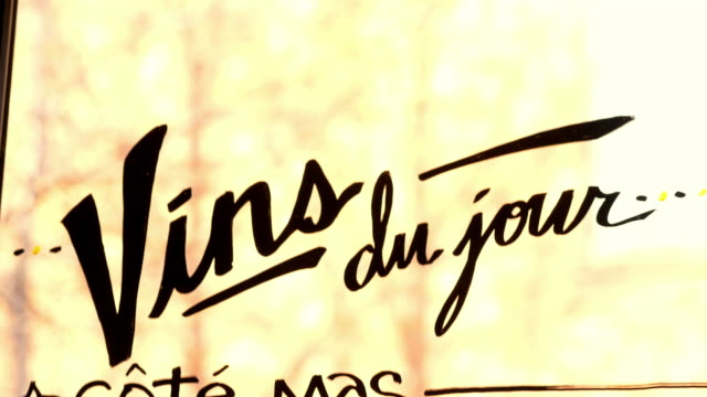 french wine menu sign hand written on window of restaurant - france stock videos & royalty-free footage